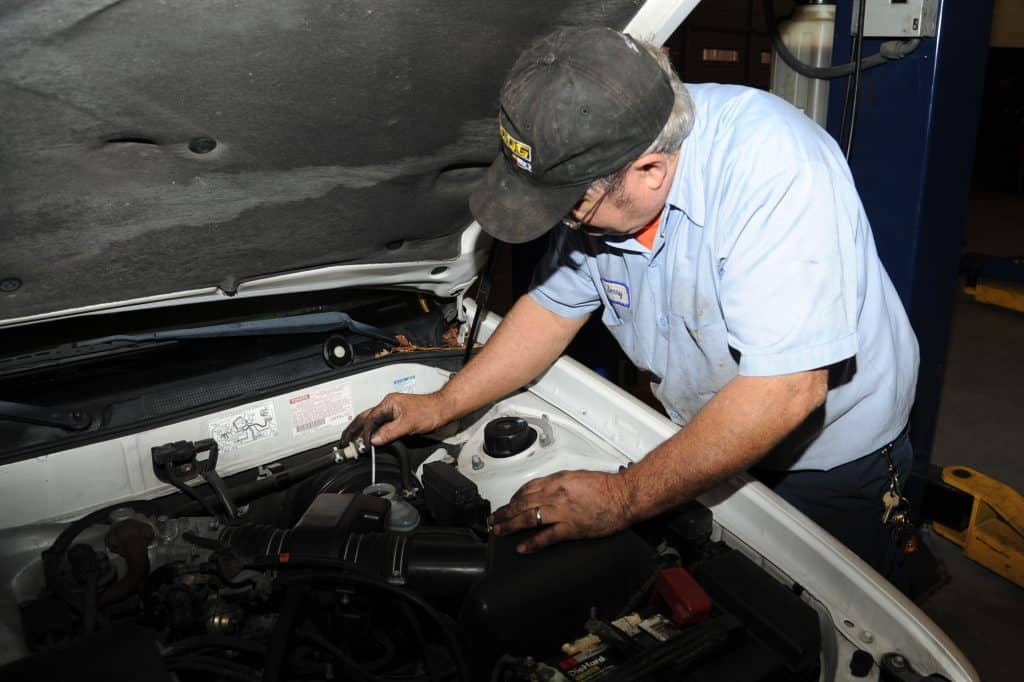 mechanic checking break fluid